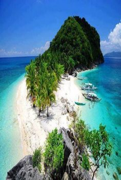 "One of the Isla De Gigantes Islands, Philippines,  ""Cabugao Island is composed of ""two"" beaches, inviting waters perfect for swimming,  spacious soft sands for sunbathing, and beautiful rock formations for climbing for a great view of the beaches and the vast ocean."""