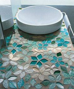 Tile mosaic bathroom counter top in blue hues. So pretty. And I think the vessel sink works well with this counter top.