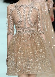 This is simply divine. It would be an interesting choice for a wedding dress...or, like, a Tuesday :)