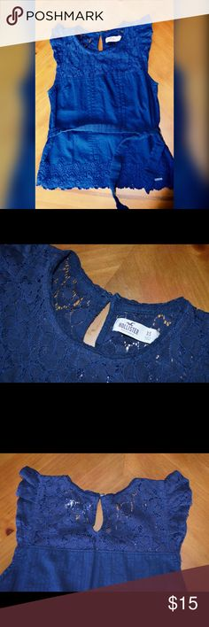 Adorable Hollister Top Navy blue. Keyhole opening in back with button. Tie around belt. I used to wear this shirt a lot and loved it but it's too small on me now. Great condition. Lace floral designs. Hollister Tops Tank Tops