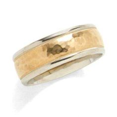 I've tagged a product on Zales: Men's 8.0mm Comfort Fit Hammered Wedding Band in 14K Two-Tone Gold. This is totally going to be Eli's wedding band! He said I could pick it out and this is the one!