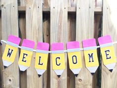 "by Beth Watson Back to School time is fast approaching (August 10th for Southwest Florida) and I have created this Pencil Banner so all of my crafty teacher friends can ""WELCOME"" their students back to class in style!    Materials:  	9"" x 12"" craft cuts Kunin™ Eco-Fi™ Classicfelt™  in Black (1); Silver Gray (1); Sandstone (1); Candy Pink (1) and Gold (3) 	JOY SA Varsity Block Letters, self-adhesive 3"" tall in Black - WELCOME 	Beacon Adhesives Felt Glue 	Ranger Ink Stickles™ Glitter Glue in…"