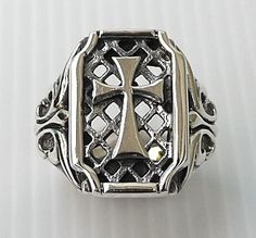 http://www.bikerringshop.com/Gothic-Cross-Mens-Ring-p/3383.htm