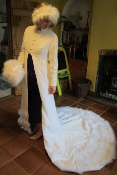 Unique winter wedding ensemble: stunning ivory velvet and marabou feather open gown, muff and headress. £120.00, via Etsy.