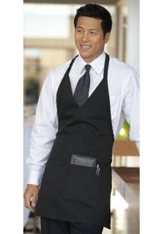 This black tuxedo apron comes with an adjustable v-neck and 2 pockets. Elevate any server's uniform to a formal look for an affordable price at Chef's Closet. Cafe Uniform, Hotel Uniform, Restaurant Aprons, Restaurant Uniforms, Staff Uniforms, Work Uniforms, Barista, Waitress Outfit, Black Apron