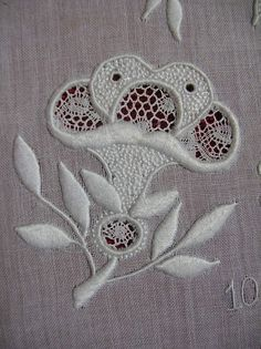 Nice example of whitework embroidery with needle lace accents.