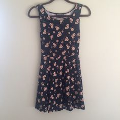 Brandy Melville Floral Cutout Dress Super cute and soft washed fabric floral skater dress with a cutout in the back. So easy to wear! Hardly worn. #brandymellville Brandy Melville Dresses Mini