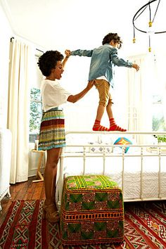 Solange Knowles and her son in her Brooklyn brownstone's bedroom.