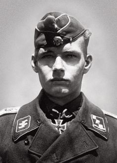 ✠ ☠ ϟϟ Waffen-SS Obersturmführer Rudolf von Ribbentrop, son of German Foreign Minister J. Von Ribbentrop. He was awarded the Iron Cross for actions on the Western front, then the Finnish Freedom Cross as a platoon leader defending Finland and then the Knight's Cross to the Iron Cross for his actions on the Eastern front. 'The Allies' hanged his father but he, though wounded in action five times, survived the war, still alive as of 2015.
