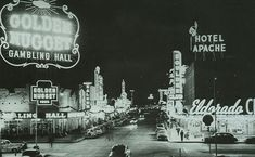 Vintage Las Vegas photo of Fremont Street and the old Golden Nugget casino neon sign (now in the Neon Boneyard).
