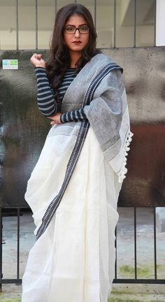 Black and White Linen Saree: paired with a striped sweater. Mulberry's Pinned by Sujayita