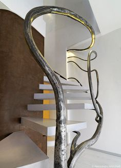 Alessandro Marchelli designs a tree-like sculpture to act as the railing around the stairs