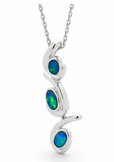 Eccentric & chic Opal pendant. Our designers use three stunning oval shape Australian light opal doublet stones, sourced from the opal producing region of Coober Pedy, South Australia, we beautifully set this pendant in sterling silver and plate 18k white gold. The simplicity of the design makes them perfect for everyday wear. The colour of the opal also makes them a great additional to any jewellery collection. #opalsaustralia