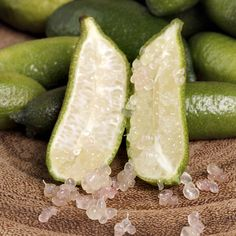 Fingerlimes are rare, gherkin-sized beauties that charm with their elegant nickname—they're known as caviar limes—and an incredible texture. Split one open lengthwise and spoon out a few pearls; as with caviar, the tiny beads inside pop in your mouth, releasing a splash of bright, tart juice.