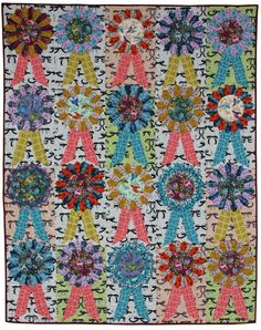 The Dresden Plate quilt block was named after the ornately decorated tableware of Dresden, Germany.  These quilts brightened many households...
