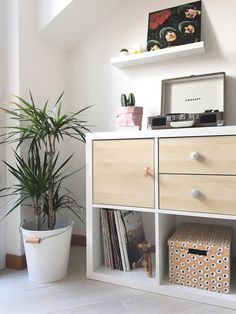 Scandinavian interior IKEA hack; customising a KALLAX shelving unit with birch wooden doors and drawers as well as three different knobs