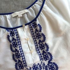 """Embroidered LOFT Top White embroidered LOFT shirt with blue stitching at front. Excellent condition, only worn once. 71% Cotton, 29% Silk. Shoulder to hem measures 23.5"""". LOFT Tops Blouses"""
