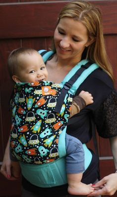 Carry your toddler on your front or your back with this 5 star Toddler Tula in Rockets