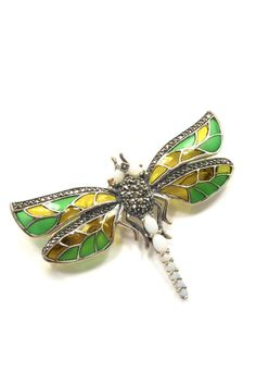 "This French Enamel and Sterling Silver Brooch is sure to make a statement on a sweater, jacket or coat. It's translucent wings are so pretty.    Measures 2.25"" across and 1.5"" in length.   Dragonfly Brooch by The Story Of Love. Accessories - Jewelry Toronto, Canada"