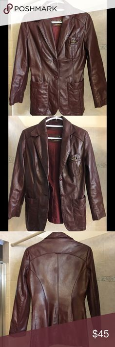 Gorgeous brown/maroon leather blazer jacket. This beautiful authentic leather jacket is a deep maroon/brown color.  It has two front lower pockets and one breast pocket with a gorgeous metal detail.  It is an Etienne Aigner.  Shell is 100% genuine leather and lining is 100% acetate.  It states a size 8, but fits more like a small.  The spots on the back are from the lighting.  There are actually no spots on the leather.  It has been cleaned and the leather treated in just the last two weeks…