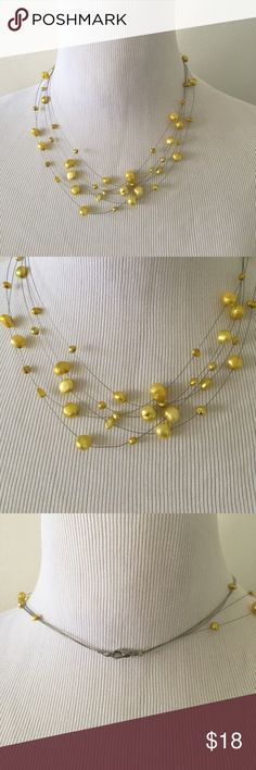 "Yellow freshwater pearl illusion necklace 18"" Gorgeous 5 strand fresh water pearl necklace on silver wire. Creates the illusion that the pearls are floating on your skin. Can be worn for a romantic night out or with a cute, casual summer dress. Length 18 inches. Jewelry Necklaces"