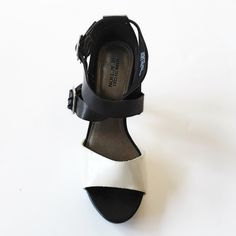 | Kenneth Cole | Colorblock Sandal Heel  Kenneth Cole Reaction Colorblock Sandal Heel in black and White. Cool Daze model. Gently Worn. All manmade materials. Approx. 4inch heel. Must have for the summer look☀️ Kenneth Cole Reaction Shoes Heels