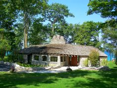 Charlevoix, Michigan~ an Earl Young house on Lake Michigan ~Google Image Result for http://ilovedetroitmichigan.com/wp-content/gallery/northwestern-lower-mi/earl-young-house-1-charlevoix-michigan.jpg