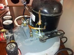 How to make a super quiet air compressor using an old fridge compressor.