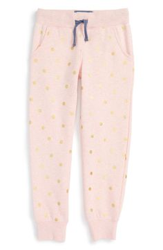 Whether she's trying out the comfy athleisure trend or just lounging on the couch, she'll love these cuffed  pink sweatpants with gold polka dots.