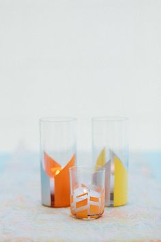 These geometric painted votive holders would make a fun addition to a mod wedding.  Source: Ruffled Blog