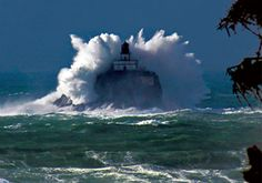 Tillamook Rock Lighthouse on the Oregon Coast--It's on a tiny island just off the coast, so it sometimes gets hit with enormous waves.