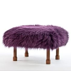 Delyth in Aubergine is so sweet, the 'Delyth' style has hand turned dark oak coloured legs ending in little hoofs. The luxury sheepskin footstool is handmade in beautiful North Wales. The cover is a removable real British sheepskin cover.