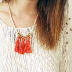 Create this necklace from scratch using cotton, jumps rings and a few findings. Tutorial includes how to make the cord, tassels and clasp!