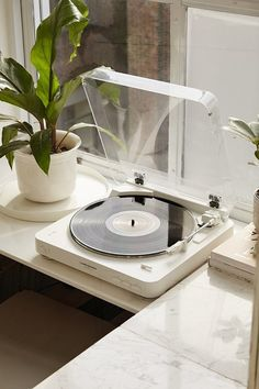 / white record player