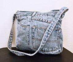 Denim Jean Purse,bag, Shoulder Bag  Super cute blue colored jean pants denim purse Purse has zippered closure 2 outside pockets Lined interior  PLEASE SEE MEASUREMENTS Measures: 12 x 10 Strap: 30 with a 13 drop   bl147