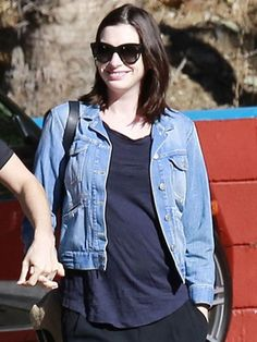 Anne Hathaway smiles as she steps out with husband Adam Shulman ...