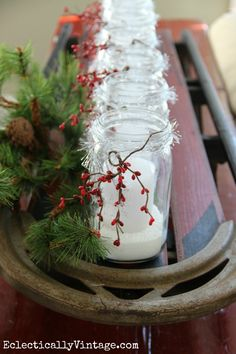 Vintage sled holds a row of snowy mason jar candles - so easy to make and gorgeous! eclecticallyvintage.com