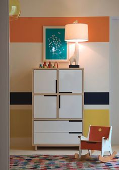 A Modu-licious storage shelf ties together a cute and subtle childrens room.