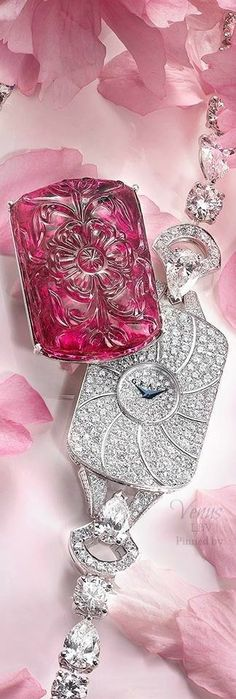 Graff Diamonds Exquisite carved rubellites conceal beautifully designed and handcrafted diamond watch dials