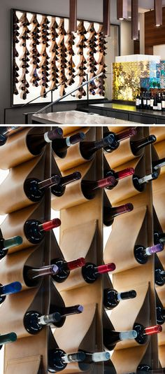 This renovated restaurant in Toronto, features a unique custom designed wine display made from leather that cradles the bottles of wine. It is also back lit and framed behind a glass wall, making it more like a piece of artwork than a storage solution. Wine Glass Shelf, Wine Shelves, Wine Glass Rack, Wine Storage, Glass Shelves, Wine Rack, Bottle Display, Wine Display, Wine Shop Interior