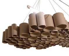 These unique carton tube shades are created when recycling meets design. Recycling is a key concept of modern waste management and is the third component of the waste hierarchy. While recycling has grown in general, recycling of specific materials. Cardboard Tube Crafts, Cardboard Rolls, Cardboard Playhouse, Florescent Light Cover, Recycled Lamp, Tube Carton, Cardboard Furniture, Toilet Paper Roll, Light Covers