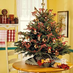 Small Tabletop Tree -   Decorate a small tree with simple homemade ornaments for a welcoming kitchen decoration