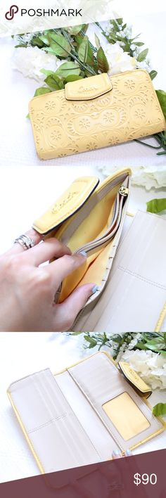 Coach Yellow Laser Cut Wallet Has card slots, coin pouch, and ID spot.  Slots for bills and receipts. Small black mark on the button closure as pictured. Coach Bags Wallets