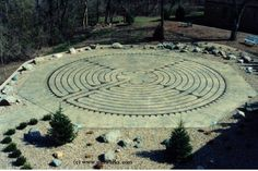 Fatima Labyrinth - This custom designed, Labyrinth is a 42-foot Replica of the Chartres Cathedral Labyrinth built in 1201 A.D.  The labyrinth was created in designer concrete with textures and tints to to appear as ancient stone, and the landscape compliments the contemplative, reflective, meditative needs of the labyrinth walker. The setting is west of the Chapel and the path is oriented to face East on entering.