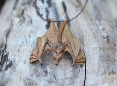 Hand Carved Wooden Bat Pendant by Giles Newman