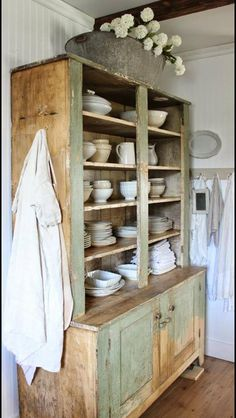 dying for this gorgeous rustic cabinet filled with beautiful white dishes & vases :)