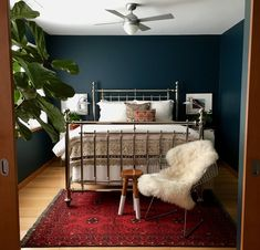 """I don't think I really have a favorite room, but I do have a soft spot for my master bedroom. There's nothing better than reading in bed at night surrounded by those deep blue walls with lamplight glinting off the sequined Moroccan bedspread—it's like m Dark Blue Bedroom Walls, Blue Master Bedroom, Bedroom Red, Home Bedroom, Dark Blue Walls, Red Walls, Bedroom Decor Dark, Black Bedrooms, Dark Master Bedroom"