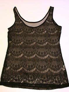 Use an old tee to line a lace top and change it into a tank.