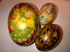 Old Easter egg candy containers and an antique decoupage egg.