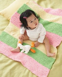 This blanket with soft textured stripes is great for snuggling! Shown in Bernat Pom Pom.